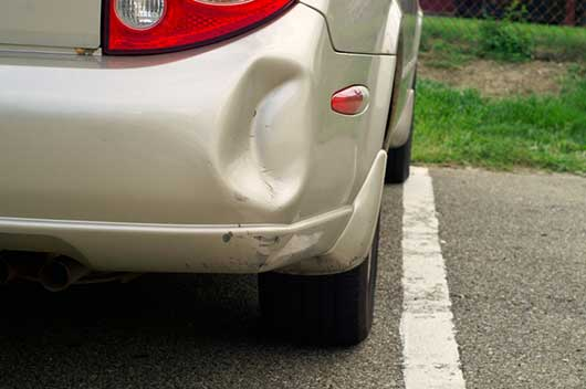 car bumper dent caused by uninsured driver